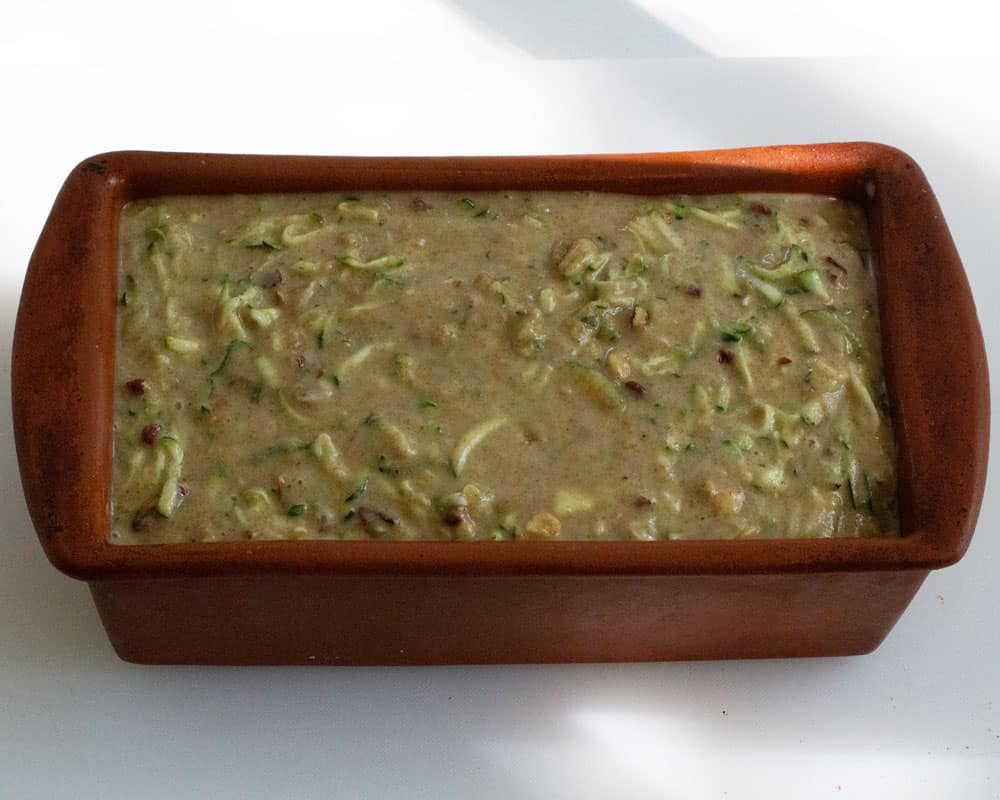 zucchini bread in loaf pan ready to bake