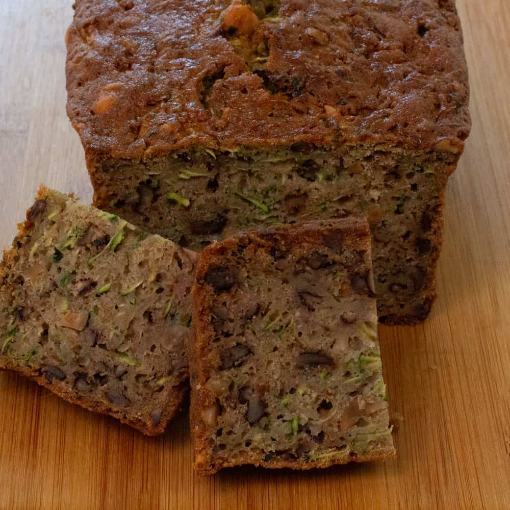 zucchini bread slices in front of loaf