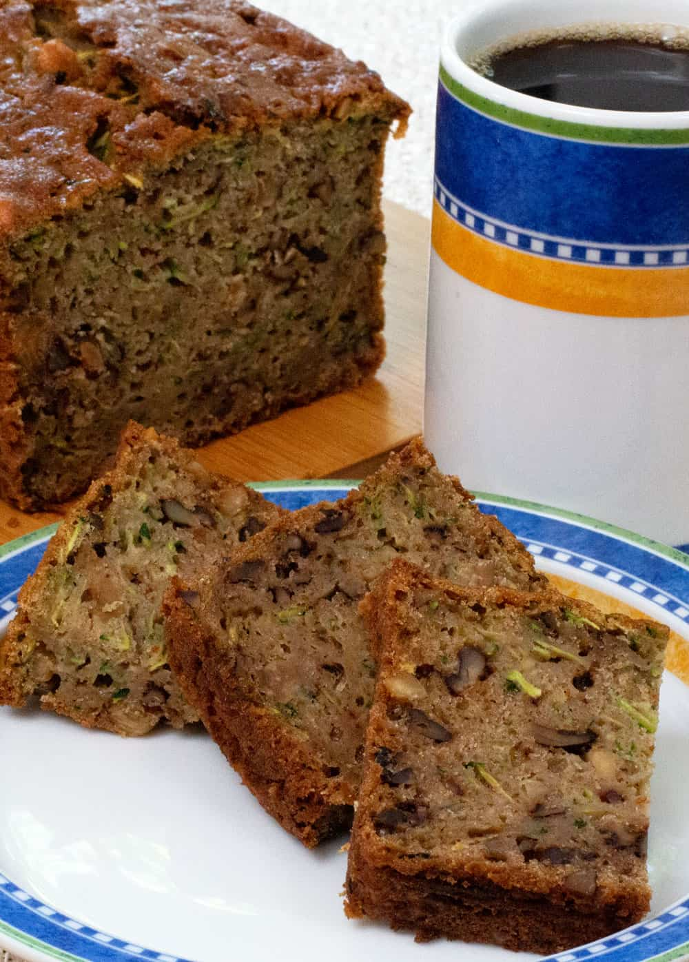 zucchini bread with a cup of coffee